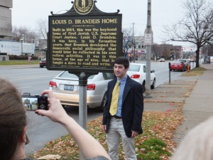 Andrew Segal beside the plaque.