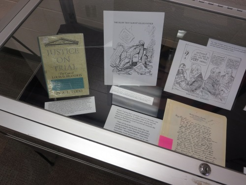 Left side of the display case.
